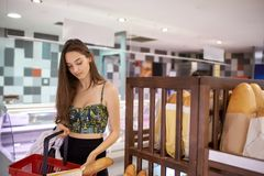 Young woman shopping in supermarket Royalty Free Stock Image
