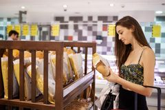 Young woman shopping in supermarket Stock Photo