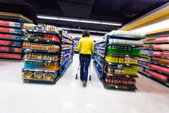 Young woman shopping in the supermarket ,motion blur Stock Photo