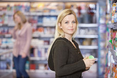 Young Woman Shopping At Supermarket Stock Photo