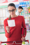 Young woman shopping at the supermarket Stock Photo