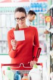Young woman shopping at the supermarket stock images