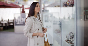 Young woman shopping in an urban mall Stock Photo