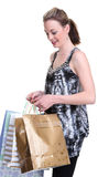 Young woman shopping on white. Pretty young woman with shopping bags on white Royalty Free Stock Image