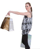 Young woman shopping on white. Pretty young woman with shopping bags on white Stock Image