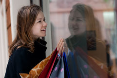 Young woman with shoppingbags Stock Photos