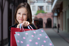 Young woman with shoppingbags Stock Photo