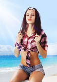 Young woman on shore Stock Photography