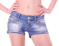 Young woman in short blue jeans Stock Photo