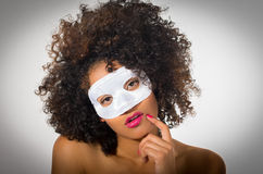 Young woman with short curly dark hair wearing a Royalty Free Stock Photography