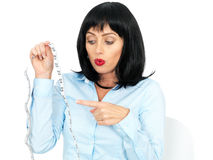Young Woman With Short Dark Hair Holding Tape Measure Royalty Free Stock Photography