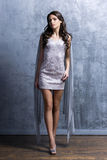 Young woman in a short dress in a studio Royalty Free Stock Photo
