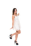Young woman in short gown and high heels in front of white backg Royalty Free Stock Photo