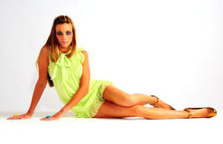 Young woman in short green dress Stock Photography