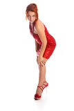 Young woman in short red dress Royalty Free Stock Photography