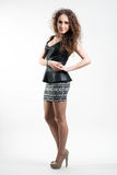 Young woman in short skirt Royalty Free Stock Image