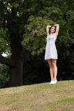 Young woman short summer dress standing in forest Royalty Free Stock Photo