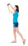 Young woman in shorts photographed something compact camera. Stock Photo