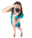 Young woman in shorts photographed something compact camera. Royalty Free Stock Image