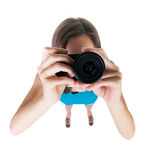 Young woman in shorts photographed something compact camera. Isolated over white background. Girl photographed us. Wide-angle picture of a distorted Royalty Free Stock Photography