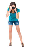 Young woman in shorts photographed something compact camera. Stock Photos