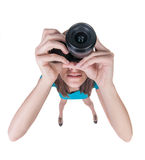 Young woman in shorts photographed something compact camera. Stock Photography