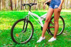 Young woman in shorts riding a sportbike stock photography