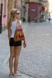 Young  woman in shorts and a t-shirt inspects an old European city. Travelling. Stock Image