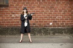 Young woman with shotgun Stock Photography
