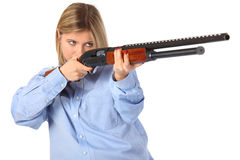 Young woman with shotgun. On white Stock Images