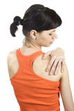 Young woman with shoulder pain. Royalty Free Stock Images