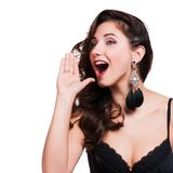 Young woman shout and scream using her hands as tube Stock Image