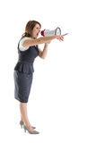 Young woman shouting into bullhorn as she gestures Royalty Free Stock Image