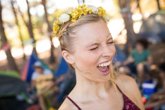Young woman shouting with eyes closed at campsite Stock Photography