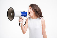 Young woman shouting into loudspeaker Stock Image