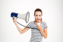 Young woman shouting into loudspeaker Stock Photography