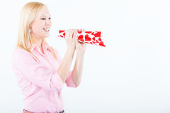 Young woman shouting with love trumpet Royalty Free Stock Photos
