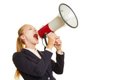 Young woman shouting into megaphone Stock Photos