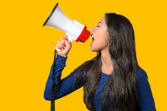 Young woman shouting into a megaphone Stock Photos