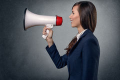 Young Woman Shouting with Megaphone Royalty Free Stock Images