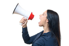 Young woman shouting into a megaphone Royalty Free Stock Photos