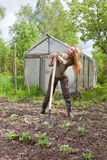 The young woman with a shovel Stock Photo