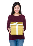 Young woman show with big gift box Royalty Free Stock Images