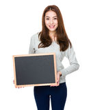 Young woman show with black board Stock Photos
