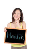 Young woman show a blackboard and smiling happy looking at camer Royalty Free Stock Photo