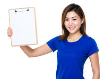 Young woman show with clipboard Stock Photography