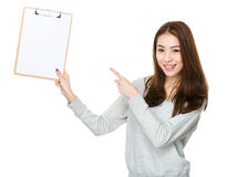Young woman show with clipboard Stock Images