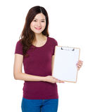Young woman show with clipboard. Isolated on white background Royalty Free Stock Image