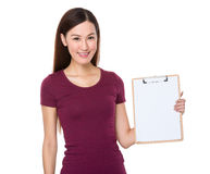 Young woman show with clipboard Stock Photo