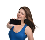 Young woman show display of mobile cell phone with blank black s Royalty Free Stock Photography